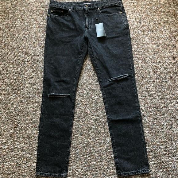 84e90b291b1 Saint Laurent distressed skinny jeans. NWT. Saint Laurent.  M_5b55ef41dcf8551a078b56e4. M_5b55ef439e6b5b17d91efd24.  M_5b55ef4574359b60881e3399